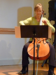 Alumnus playing cello